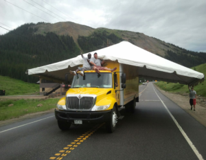 Rental Tent Straddling Party Time Rental Delivery Truck