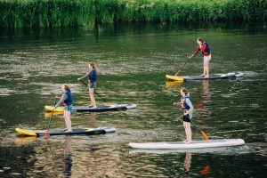 Team building ideas include paddle boarding